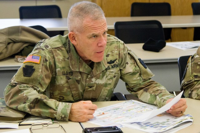 Col. Howard Lloyd, the commander of the 28th Expeditionary Combat Aviation Brigade, networks with leaders from other units at the Northeast Regional Partnership Conference, Jan. 15-16, 2020, at Fort Drum, N.Y. The purpose of the conference is to promote former Chief of Staff of the U.S. Army  Gen. Mark A. Milley's vision of a total Army conference, where Active Duty, National Guard, and Reserve units all work together to mutually benefit one another.