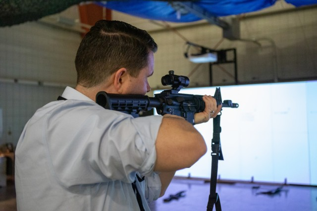 Shane Snelling, G2 Senior Intelligence Analyst, 1st Theater Sustainment Command (TSC), fires a M4 rifle at his target while using the Squad Advanced Marksmanship-Trainer (SAM-T) Jan. 16, 2020 at the Virtual Training Facility on Fort Knox, Ky.