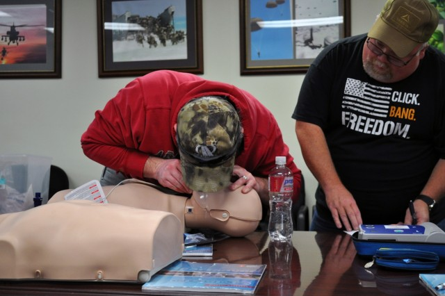 A Crane Army employee administers mouth-to-mouth CPR to a training dummy at a session in November. The hour and a half-long class teaches those involved how to respond in an emergency situation where CPR will be necessary. Crane Army specializes in conventional munitions support for U.S. Army and Joint Force readiness, including storage, quality control, shipment preparation, distribution, production and demilitarization.