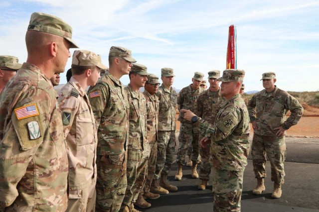 U.S. Army Col. John Dawber (second from right), commander, 11th Air Defense Artillery Brigade, congratulates Soldiers at the conclusion of Operation Shining Star, Nov. 9, 2019.  Operation Shining Star was a successful tri-national Patriot missile system live-fire exercise to improve interoperability and joint training held at McGregor Training Complex, Fort Bliss, Texas. (U.S. Army photo by Sgt. Mariah Jones, 11th ADA BDE)