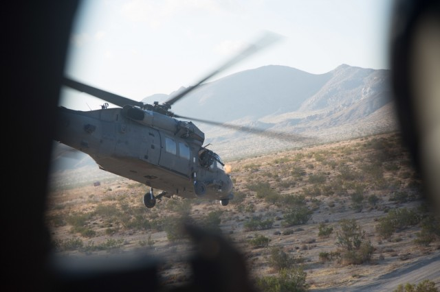 A UH-60 Black Hawk helicopter from the Joint Aviation Command, United Arab Emirates, conducts a live-fire assault on an objective during an air assault mission at the National Training Center during Decisive Action Rotation 17-09, Sept. 21, 2017.  (U.S. Army photo by Sgt. David Devich, Operations Group, National Training Center)