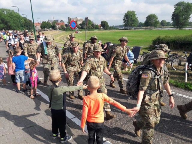 Team Way Too Far completes 100-mile march as one