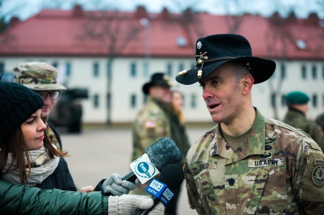 U.S. Army Lt. Col. Andrew Gallo, (right) commander assigned to the 3rd Squadron, 2d Cavalry Regiment, conducts an interview with local media following the transfer of authority ceremony in which he took command of NATO's enhanced Forward Presence Battle Group Poland in Bemowo Piskie, Poland, Jan. 20, 2020. NATO's enhanced Forward Presence consists of four battalion-sized battle groups deploying on a persistent rotational basis to Estonia, Latvia, Lithuania and Poland to demonstrate the alliance's determination and ability to act as one in response to any aggression against its members. (U.S. Army photo by Sgt. Timothy Hamlin)
