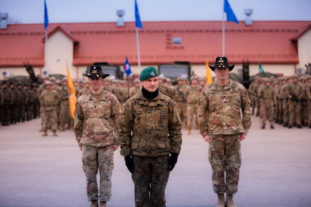 U.S. Army Lt. Col. Andrew Gallo, (left) commander assigned to the 3rd Squadron, 2d Cavalry Regiment, Polish Army Col. Bogdan Rycerski, (center) commander assigned to the 15th Mechanized Brigade, and Lt. Col. Mark O'Neill, (right) commander assigned to 3rd Squadron, 278th Cavalry Regiment, stand in front of the NATO enhanced Forward Presence Battle Group Poland formation in Bemowo Piskie, Poland, Jan. 20, 2020. NATO's enhanced Forward Presence consists of four battalion-sized battle groups deploying on a persistent rotational basis to Estonia, Latvia, Lithuania and Poland to demonstrate the alliance's determination and ability to act as one in response to any aggression against its members. (U.S. Army photo by Sgt. Timothy Hamlin)