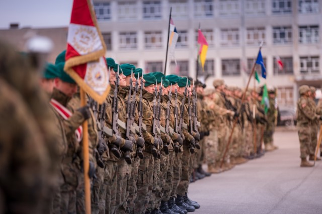 Soldiers from Poland, Croatia, Romania, United Kingdom and the United States stand in unison during a transfer of authority ceremony for the NATO's enhanced Forward Presence Battle Group Poland in Bemowo Piskie, Poland, Jan. 20, 2020. NATO's enhanced Forward Presence consists of four battalion-sized battle groups deploying on a persistent rotational basis to Estonia, Latvia, Lithuania and Poland to demonstrate the alliance's determination and ability to act as one in response to any aggression against its members. (U.S. Army photo by Sgt. Timothy Hamlin)