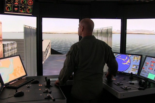 Navy Chief Petty Officer Jake Muehls, a Landing Craft Air Cushion Craftmaster, virtually pilots a vessel in ERDC's ship simulator. ERDC has used ship simulator and vessel-response models since the early 1980s to evaluate federally maintained navigation channels, and has recently begun to apply the state-of-the-art technology to military uses. It gives leaders a tool to simulate vessel landings in severe environments.