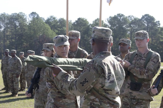 207th Regional Support Group Command Sgt. Maj. David Douthat cases the support group's 'colors' during a deployment ceremony at Fort Jackson's Hilton Field Oct. 26. The support group will deploy in support of Operation Inherent Resolve and provide base support operations for Soldiers and coalition forces residing on the operating base.
