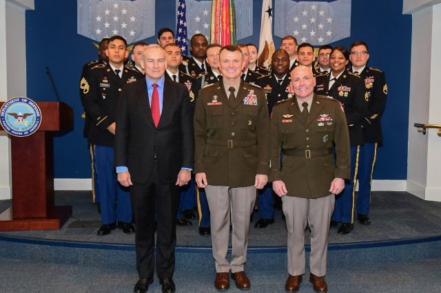 E. Casey Wardynski, left, assistant secretary of the Army for manpower and reserve affairs; Gen. Paul E. Funk II, commander of U.S. Army Training and Doctrine Command; and Maj. Gen. Frank Muth, commander of U.S. Army Recruiting Command, pose for a photograph with the top recruiters of the first quarter of fiscal year 2020 during a recognition ceremony at the Pentagon's Hall of Heroes in Arlington, Va., Jan. 22, 2020.