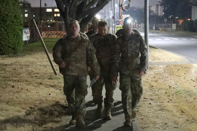 A team of airmen begins the first leg of an overnight 54-mile march the evening of Jan. 15 on Camp Zama, Japan. More than 120 participants, divided among 10 teams, completed the march to honor Martin Luther King Jr. who, along with thousands of demonstrators, walked the same distance from Montgomery to Selma, Alabama, in 1965.