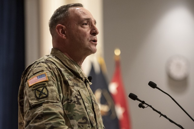 Lt. Gen. Charles Pede, U.S. Army Judge Advocate General, discusses the significance of the new FM 6-27: The Commander's Handbook on the Law of Land Warfare with judge advocates and military paralegals at the Army JAG School Jan. 22, 2020. The handbook provides guidance to Soldiers and Marines on the Law of Armed Conflict.