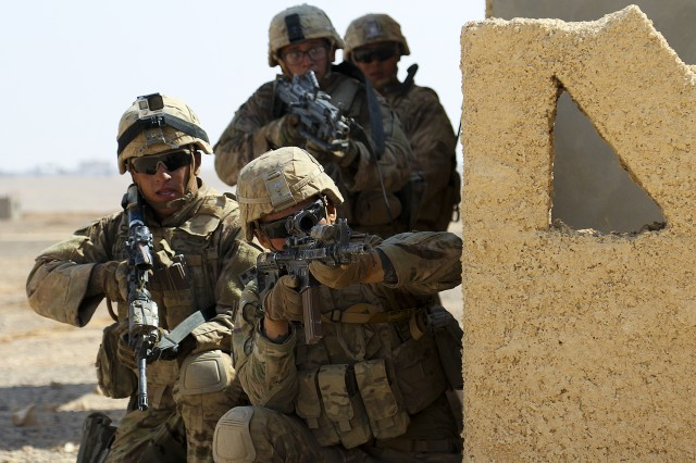 Soldiers from 3rd Armored Brigade Combat Team, 4th Infantry Division, assault an objective during a situational training exercise at an urban assault training village near Amman, Jordan, Sept. 2, 2019. In August, the Army released an updated version of its guide on the Law of Armed Conflict, Field Manual 6-27, the Commander's Handbook on the Law of Land Warfare. The publication helps guide U.S. troops comply with international and host nation laws. The manual also aids partner nations in gaining an understanding of U.S. military operations and regulations.