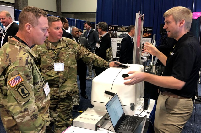 Employees of Great Lakes Sound and Vibration Inc. demonstrate their technology concept to service members at AUSA in October. The company was a finalist in xTechSearch 2.0, which provides small businesses with a platform to showcase their technologies to Army experts and now offers an accelerator program, increased collaboration opportunities and opportunities for small businesses to engage on social media.