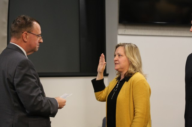 Dr. James Kirsch re-administers the oath of office to Dr. Donna Joyce during her senior research scientist appointment ceremony Jan. 21 at the U.S. Army Combat Capabilities Development Command Aviation & Missile Center at Redstone Arsenal, Ala. Joyce, who serves at the CCDC AvMC Software, Simulation, Systems Engineering and Integration Directorate, was appointed the ST for protective technologies effective Dec. 8.