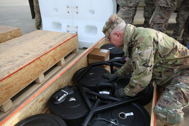 Col. Steven Carozza, military deputy executive director to the Tank-automotive and Armaments Command's Integrated Logistics Support Center, inspects Army Combat Fitness Test equipment prior to unit delivery at Fort Benning January 22.