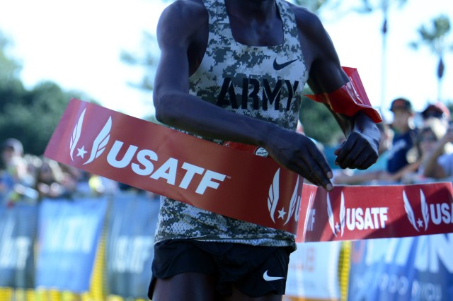 Cpl. Anthony Rotich of Fort Carson, Colo., crosses the finish line with a time of 30:36 to win both the Armed Forces Cross Country Championship and the USA Track and Field senior men 10K race at Mission Bay Park in San Diego, Calif, Jan. 18, 2020.