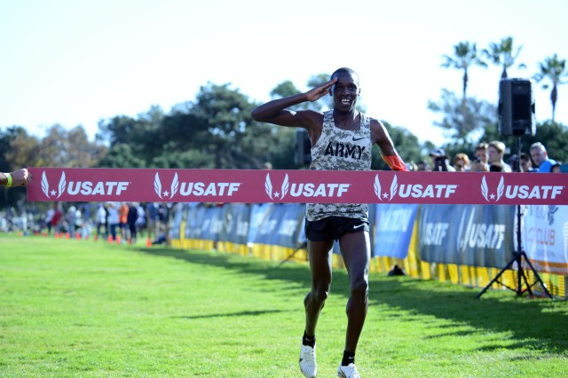 Cpl. Anthony Rotich of Fort Carson, Colo., salutes just before crossing the finish line with a time of 30:36 to win both the Armed Forces Cross Country Championship and the USA Track and Field senior men 10K race at Mission Bay Park in San Diego, Calif, Jan. 18, 2020.