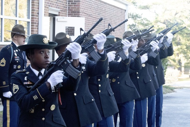 A rifle team made up of drill sergeants from 3rd Battalion, 39th Infantry Regiment, fire a 21-gun salute to honor Pfc. Connor James McGurran during a memorial service Jan. 16 at the Daniel Circle Chapel. McGurran had completed eight of his 10 week Basic Combat Training cycle when he was found unresponsive during a field training exercise.