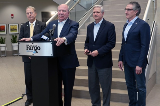The Honorable R. D. James, Assistant Secretary of the Army for Civil Works, addresses the press after a meeting with the Flood Diversion Authority at Fargo City Hall in Fargo, North Dakota, Nov. 1. Behind him are Fargo Mayor Tim Mahoney, left, North Dakota Sen. John Hoeven and North Dakota Governor Doug Burgum.