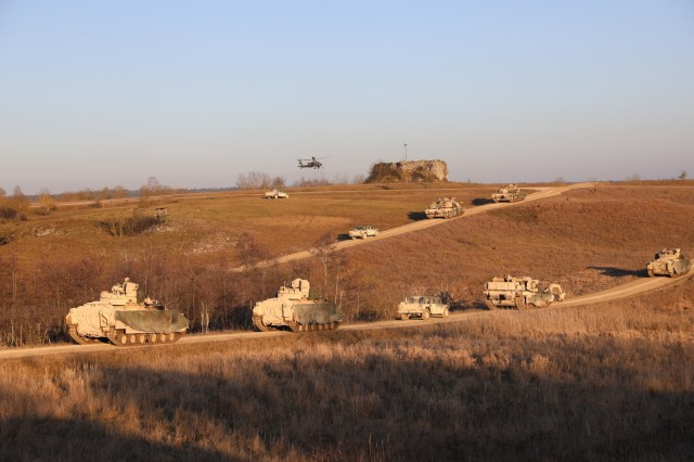 1st Battalion, 8th Cavalry Regiment, 2nd Armored Brigade Combat Team, 1st Cavalry Division's, lines up vehicles as they prepare for a live fire exercise in preparation for Combined Resolve XIII in Grafenwohr, Germany, Jan. 16, 2020. Combined Resolve XIII is a biannual U.S. Army Europe and 7th Army Training Command led exercise intended to evaluate and certify the readiness and interoperability of U.S. Forces mobilized to Europe in support of Atlantic Resolve. (U.S. Army National Guard photo by Staff Sgt. Gregory Stevens)