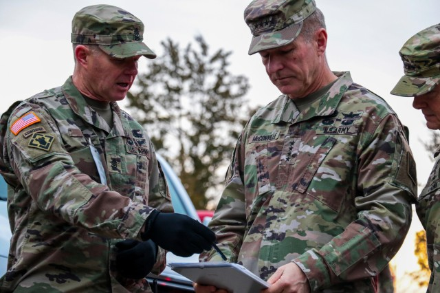 Sgt. Maj. Curtis Cox, Leader Reaction Course field noncommissioned officer in charge, briefs Army Chief of Staff Gen. James C. McConville about the course challenges and assessment criteria for each candidate during the Battalion Commander Assessment Program, Jan 23, 2020, at Fort Knox, Ky.