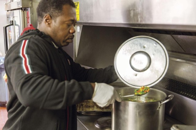 CW4 Mitchell Dascent checks on the vegetables being prepared at the Elanor Kennedy shelter, Jan. 19, as Belvoir Chapel volunteers cooked and served for the homeless guests.
