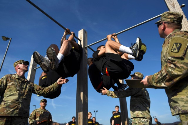 U.S. Army Advanced Individual Training students perform leg tucks during an Army Combat Fitness Test at Joint Base Langley-Eustis, Va., June 28, 2019. Leg tucks are the fifth event in the ACFT as it is a test of upper body and core muscle endurance that requires Soldiers to complete as many repetitions as possible in two minutes.
