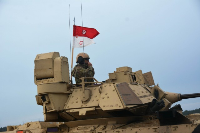 A Soldier sits atop his M2A3 Bradley Infantry Fighting Vehicle (BFV) to observe the ongoing training during a trench clearing exercise on January 15, 2020, in Pabradé, Lithuania. Service members from the 1st Battalion, 9th Cavalry Regiment, 2nd Armored Brigade Combat Team, 1st Cavalry Division 'Headhunters', participated in the exercise to improve their skills at trench and obstacle clearing. (U.S. Army National Guard Photo by Staff Sgt. Scott D. Longstreet)