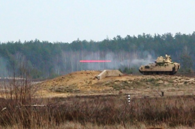 An M2A3 Bradley Infantry Fighting Vehicle (BFV) provides suppressive fire toward enemy contact in order to allow dismounted teams to get into position to clear an obstacle during a trench clearing exercise on January 15, 2020, in Pabradé, Lithuania. Soldiers from the 1st Battalion, 9th Cavalry Regiment, 2nd Armored Brigade Combat Team, 1st Cavalry Division 'Headhunters', participated in the exercise to improve their skills at trench and obstacle clearing. (U.S. Army National Guard Photo by Staff Sgt. Scott D. Longstreet)