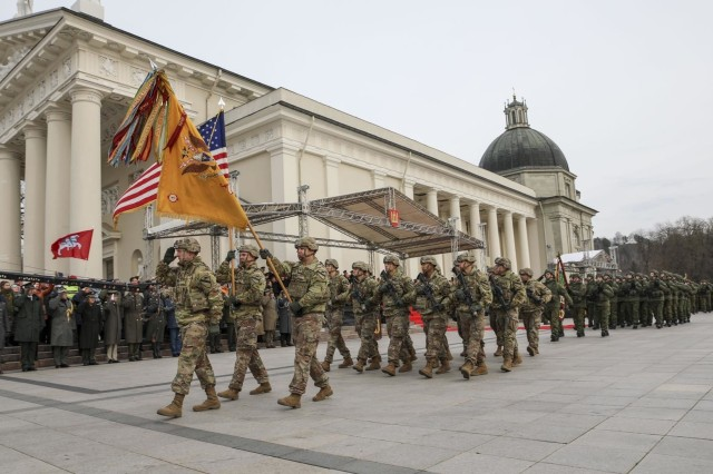 Soldiers with 'Headhunters' 1st Battalion, 9th Cavalry Regiment (Forward), 2nd Armored Brigade Combat Team, pass-in-review in front of Lithuanian President Gitanas Nauseda and other dignataries as they participate in a national parade celebrating the 101st anniversary of the restored Lithuanian Armed Forces at Vilnius Cathedral Square on Nov 23, 2019. (U.S. Army photo by Staff Sgt. Greg Stevens)