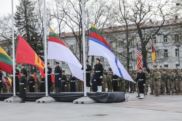 Approximately 25 Soldiers with 'Headhunters' 1st Battalion, 9th Cavalry Regiment (Forward), 2nd Armored Brigade Combat Team, participate with Lithuanian Armed Forces and divisions, members of NATO Forces Battalion, Lithuanian, Polish and Ukrainian Brigade LITPOLUKBRIG in a national parade celebrating the 101st anniversary of the restored Lithuanian Armed Forces at Vilnius Cathedral Square on Nov 23, 2019. (U.S. Army photo by Staff Sgt. Greg Stevens)
