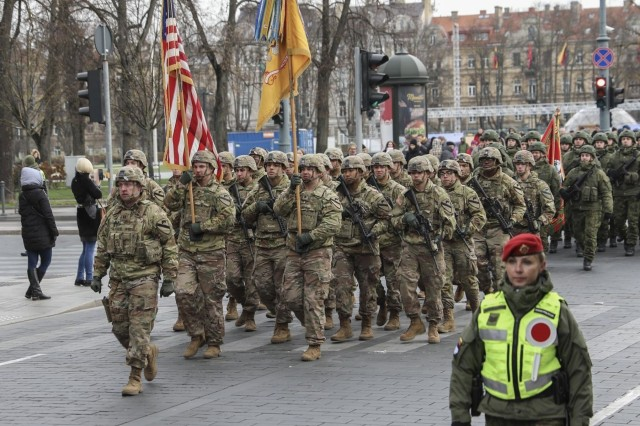 Soldiers with 'Headhunters' 1st Battalion, 9th Cavalry Regiment (Forward), 2nd Armored Brigade Combat Team, participate by marching in a national parade celebrating the 101st anniversary of the restored Lithuanian Armed Forces on Nov 23, 2019. (U.S. Army photo by Staff Sgt. Greg Stevens)