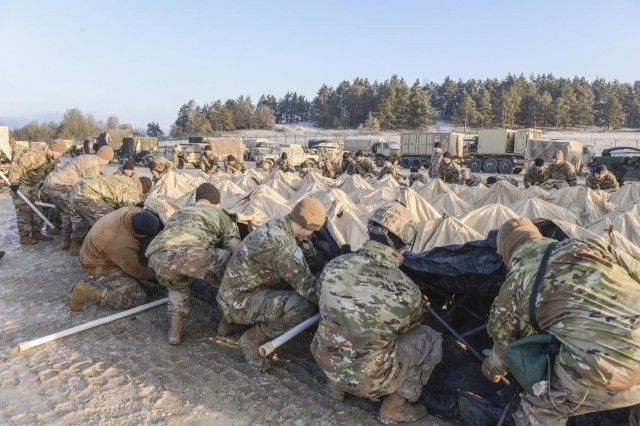 Soldiers with 2nd Armored Brigade Combat Team, 1st Cavalry Division, assemble a tactical operation center in preparation for force on force at Combined Resolve XIII in Hohenfels, Germany, Jan. 19, 2020. (U.S. Army National Guard photo by Staff Sgt. Noshoba Davis)