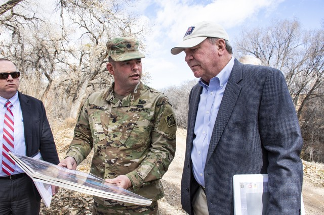 Albuquerque, N.M. -- Lt. Col. Dale Caswell, commander, U.S. Army Corps of Engineers-Albuquerque District, briefs a civil works levee project to R.D. James, assistant secretary of the Army for civil works, during James' visit to the district, Jan. 22.
