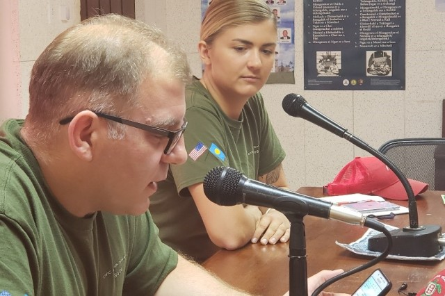 Lt. Col. David Owshalimpur, Medical Provider and Civic Medical Team leader, talks live on the radio with 1st Lt. Kirsten Walsh, CAT 84-06 OIC, on health concerns with body fat index and obesity. The CAT team conducts a live radio broadcast to increase awareness with the Palauan population.