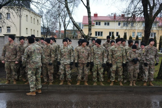 Soldiers form up prior to the start of the Road of Life and Death tribute run. Service members from the 1st Battalion, 9th Cavalry Regiment, 2nd Armored Brigade Combat Team, 1st Cavalry Division, joined Lithuanian troops and civilians in the annual Road of Life and Death tribute run on January 11, 2020, in Vilnius, Lithuania. (U.S. Army National Guard Photo by Staff Sgt. Scott D. Longstreet)
