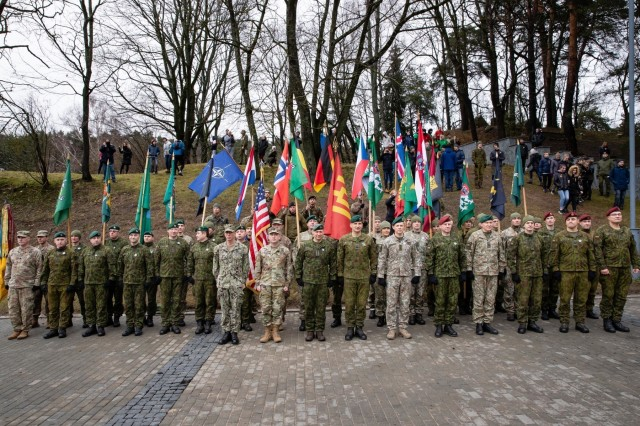 Service members from both the U.S. and Lithuania form up prior to the start of the Road of Life and Death tribute run. Soldiers from the 1st Battalion, 9th Cavalry Regiment, 2nd Armored Brigade Combat Team, 1st Cavalry Division, joined Lithuanian Soldiers and civilians in the annual Road of Life and Death tribute run on January 11, 2020, in Vilnius, Lithuania. (Photo by Corp. Michail Lysenko, Lithuanian National Defence Volunteer Forces)
