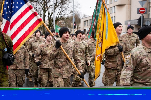 U.S. Soldiers march as part of the Road of Life and Death tribute run. Soldiers from the 1st Battalion, 9th Cavalry Regiment, 2nd Armored Brigade Combat Team, 1st Cavalry Division, joined Lithuanian service members and civilians in the annual Road of Life and Death tribute run on January 11, 2020, in Vilnius, Lithuania. (Photo by Corp. Michail Lysenko, Lithuanian National Defence Volunteer Forces)