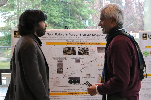Dr. Debjoy Mallick (left), CCDC Army Research Laboratory, describes his metals research to Dr. Shashi Karna, the Army's senior research scientist for nano-functional materials.