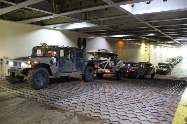Military vehicles await their turn for loading during port operations on the M/V Cape Hudson at Pearl Harbor on Jan. 22.
