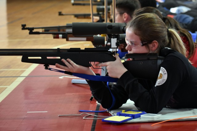 Kailey Greidanus, a member of the Zama Middle High School junior varsity Junior Reserve Officers' Training Corps marksmanship team, shoots during the Kanto Plain Invitational Three-Position Marksmanship Match at Camp Zama, Japan, Jan. 25.