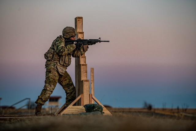 A Soldier assigned to Headquarters Support Company, 100th Brigade Support Battalion, 75th Field Artillery Brigade, Fort Sill, Okla., aims down the sight of his M4 carbine while conducting the Army's new M16 and M4 carbine marksmanship qualification at Fort Sill on January 23, 2020. The new marksmanship qualification course has been designed to replace the Cold War-era marksmanship qualification course requiring Soldiers to engage targets faster, in a variety of firing positions they may be required to take during an enemy engagement.