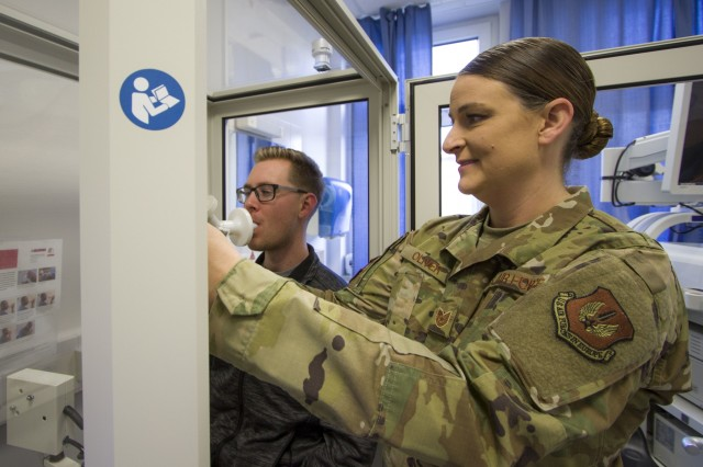 Tech. Sgt. Maranda Oliver, Cardiopulmonary Laboratory Noncommissioned Officer of the Year for USAFE-AFAFRICA, native of Beaufort, South Carolina, prepares a patient for testing at Landstuhl Regional Medical Center, Dec. 17, 2019.