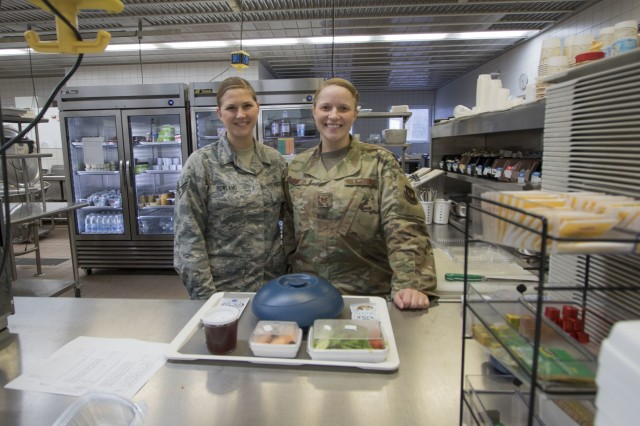 Senior Airman Kari Rowland (left), USAFE-AFAFRICA's Diet Therapy Airman of the Year for 2019, native of Crestview, Florida, and Tech. Sgt. Nataliya Hampton, USAFE-AFAFRICA's Diet Therapy NCO of the Year, native of Novovolysnk, Ukraine, prepare a patient meal at Landstuhl Regional Medical Center, Jan. 10.
