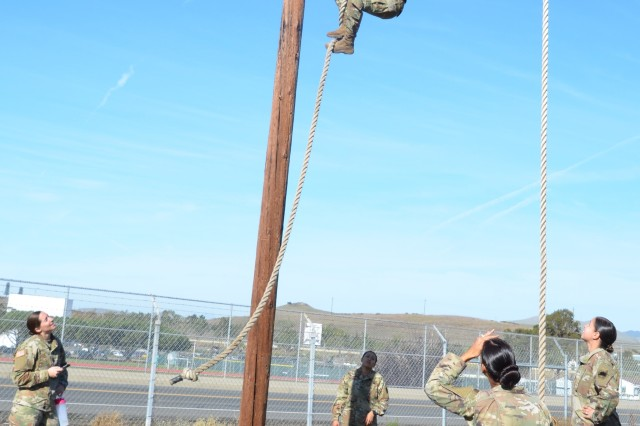 """Staff Sgt. Amber MacMillan is a 15-year veteran and new to the eight events, timed confidence course obstacles at Camp San Luis Obispo, California, Dec. 2019. She is an MFT and 92A/Automated Logistical Specialist with Headquarters and Headquarters Detachment, 1106th Theater Aviation Support Maintenance Group in Fresno. She didn't come from a fitness background in school but got into fitness after joining the Cal Guard. This course taught her how to train differently. """"We received so much good information, more than I expected in a good way, like how to work out at the unit level with alternate equipment. I can take this training back to my unit and now I have tools to help Soldiers out and to help out my unit,"""" said MacMillan."""