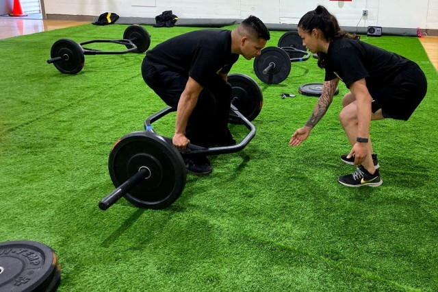"""Sgt. Autumn Jeffers, a seven-year Cal Guard veteran, emphasizes the hex bar deadlift form. She is an MFT with the 149th Chemical Company in Lathrop, Calif. Her military job is a 74D/Chemical Specialist. Jeffers trains six days a week and works with lifting and nutrition coaches. This course taught her how to approach Soldiers from all kinds of backgrounds. """"Instead of saying this is what I do, I'm now able to plan for a wider-spectrum audience,"""" said Jeffers."""