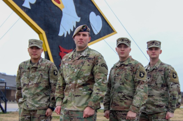 Sgt. Zachary Gibson (middle left), 227th Composite Supply Company, poses with newly assigned soldiers to 101st Airborne Division (Air Assault) Sustainment Brigade. Pvt. Chawit Chutikul (left), Human Resources Company, Spc. William Cantrell (middle right),  74th Composite Truck Company, and Spc. Daniel Blake, (right) Financial Management Sustainment Unit, 129th Division Sustainment Support Battalion, 101st Airborne Division (Air Assault) Sustainment Brigade.