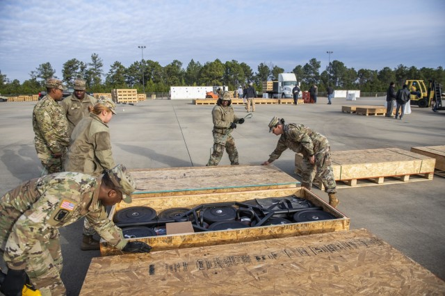 FORT BENNING, Ga. -- At Fort Benning Jan. 21, Soldiers prepare to inventory crates containing equipment their unit needs for the Army Combat Fitness Test, or ACFT, which becomes the Army's official fitness test-of-record Oct. 1. The Army is in the process of shipping thousands of sets of the ACFT gear to units Army-wide. For Fort Benning's units and three Army ROTC programs in the area, trucks arrived here Jan. 16 and 17 and delivered more than a quarter-of-a-million pounds of the gear. Unit leaders at Fort Benning welcomed the delivery, saying it'll help their efforts to get Soldiers trained in the ACFT's six events, and also aid their overall physical conditioning.