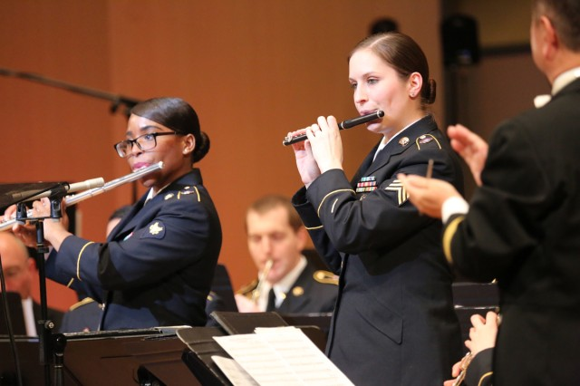 """Sgt. Jini Zuniga, assigned to the U.S. Army Japan Band, right, plays flute during the band's seventh annual performance, this year titled """"An American Concert,"""" held Dec. 20 and 21, 2019, at Zama Harmony Hall in Zama City."""