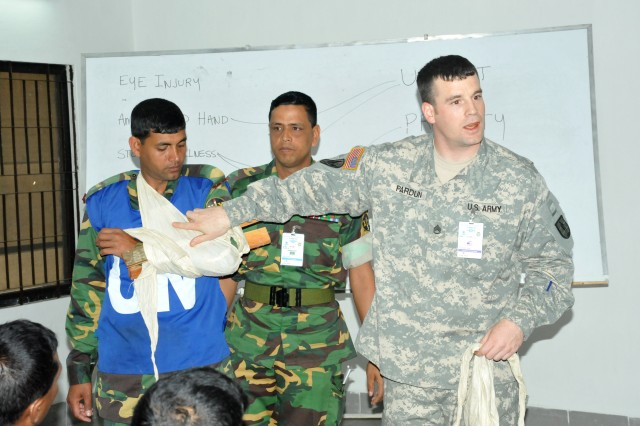 Army Staff Sgt. Tyson Pardun of the Oregon Army National Guard demonstrates a basic splint to a Bangladeshi military platoon during Exercise Shanti Doot-3 in Bangladesh, March 15, 2012.