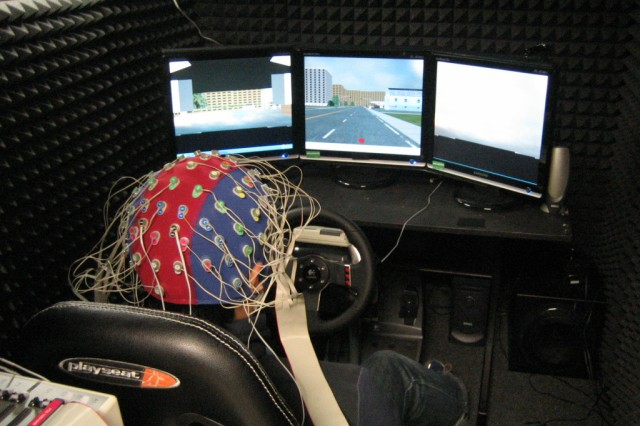 Researchers use an EEG to measure brain activity during a simulated driving experiment.